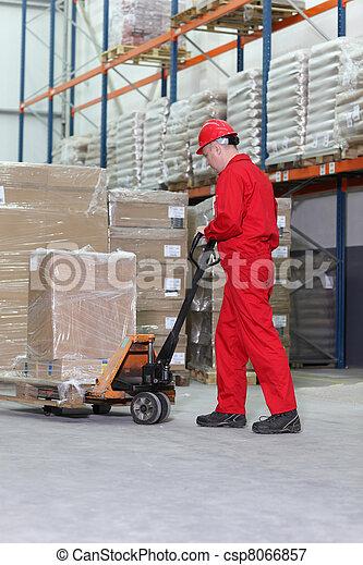 worker with pallet jack - csp8066857