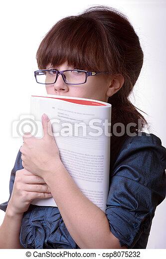 Portrait of young alluring brunette woman, holding book on white background - csp8075232