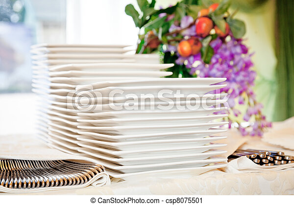 Stacks of white plates - csp8075501