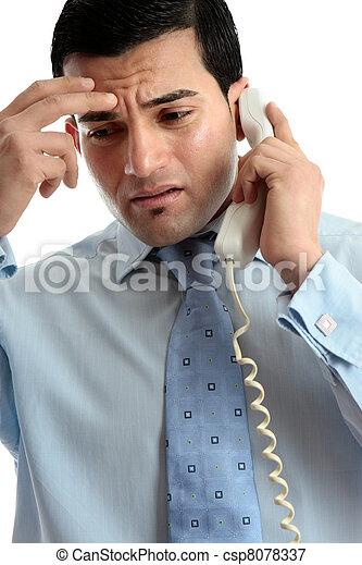 Stressed  depressed man businessman on phone - csp8078337
