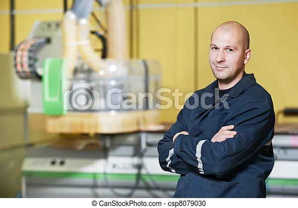 worker at tool workshop - csp8079030