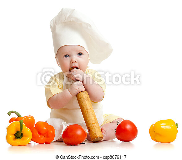 Portrait of a baby wearing a chef hat with healthy  food vegetables, isolated on white - csp8079117