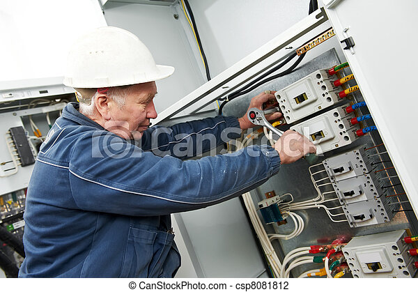 Electrician tighten the screws with spanner - csp8081812