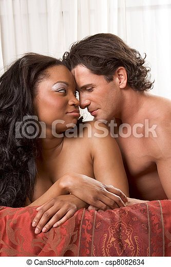 Interracial heterosexual sensual couple in love - csp8082634