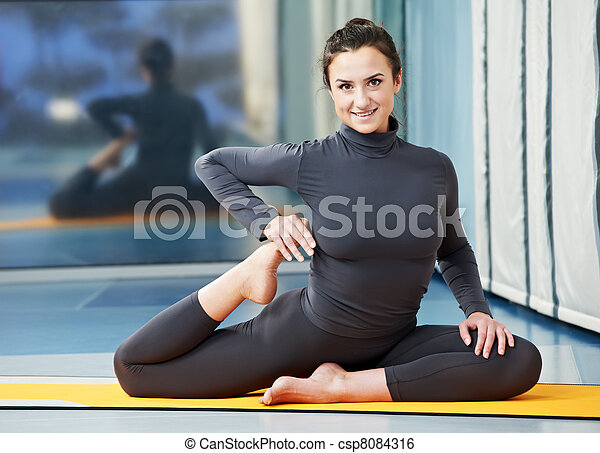 Happy smiling woman at gymnastic fitness exercise - csp8084316