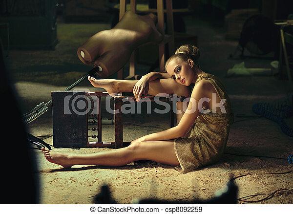 Blonde model posing in a grunge interior - csp8092259