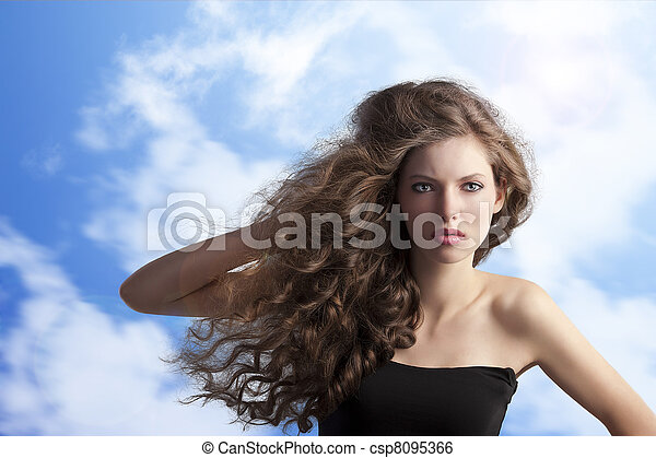 brunette with creative hairstyle in sky - csp8095366