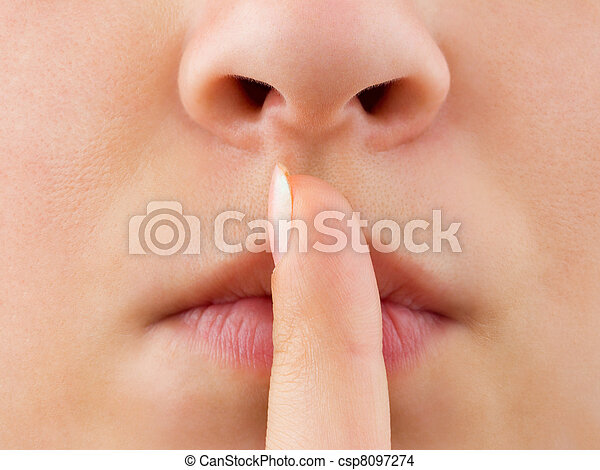 Woman holding finger to lips - csp8097274