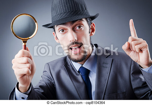 Detective and magnifying glass - csp8104364