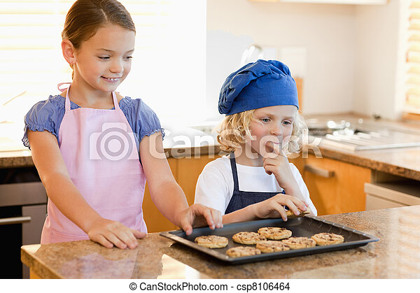 Siblings stealing cookies - csp8106464