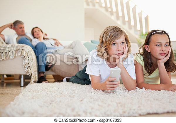 Siblings bored by tv program - csp8107033
