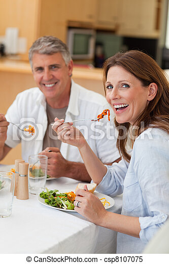 Happy couple eating dinner together - csp8107075