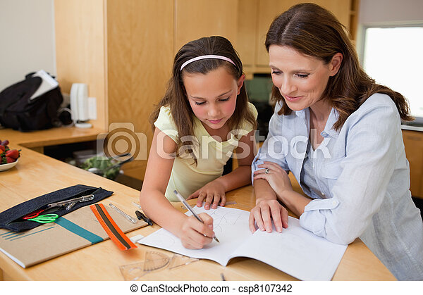 Girl doing homework with her mother - csp8107342