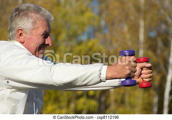 old man with dumb bells - csp8112196