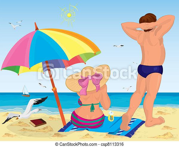 Married couple on the beach under umbrella - csp8113316