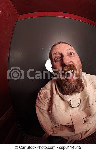 Insane man in a straitjacket - csp8114545