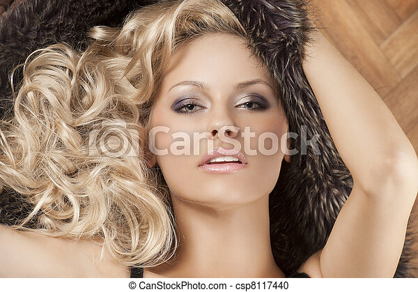 alluring girl with blond curly hair - csp8117440