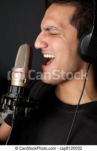 Rock artist recording his song in a studio