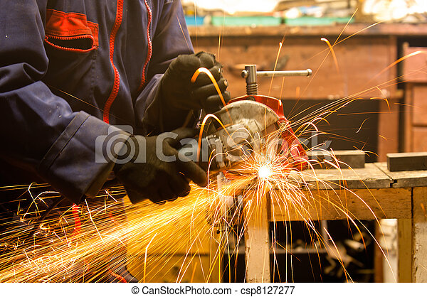 Circular saw and a worker in a hard job - csp8127277