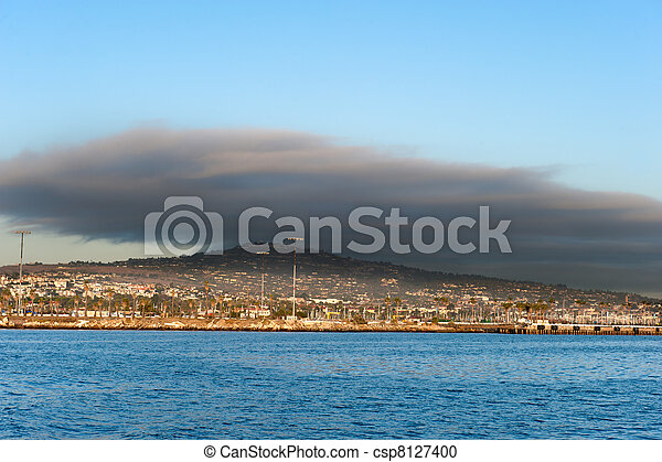 Dark cloud over oceanfront land - csp8127400
