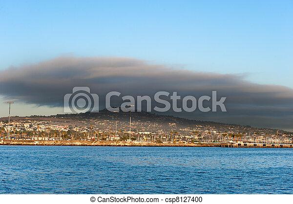 Dark cloud over oceanfront land - csp8127400