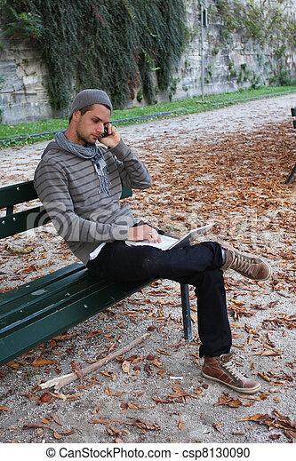 stock fotografie von bank telefon netbook drau en schreibende mann mann csp8130090. Black Bedroom Furniture Sets. Home Design Ideas