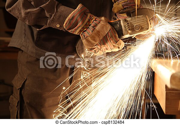 Worker with angle grinder only hands - csp8132484