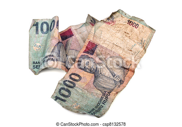 Conceptual photo of old dirty crumpled Indonesian Rupiah, illustrating criminal money, white washing or how cheap they are. - csp8132578