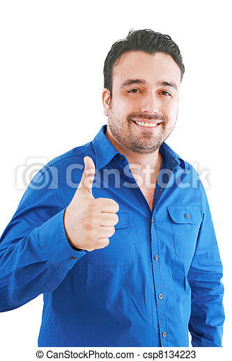 Happy casual young man showing thumb up and smiling isolated on white background - csp8134223