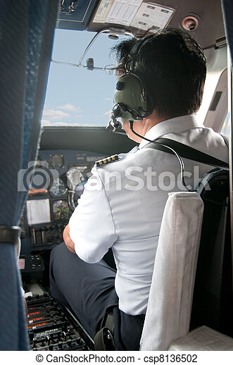 Pilot in a cockpit preparing for Take-off - csp8136502