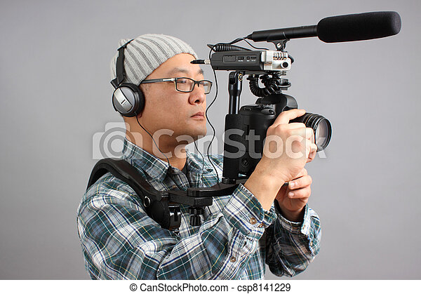 Man with HD SLR camera and audio - csp8141229
