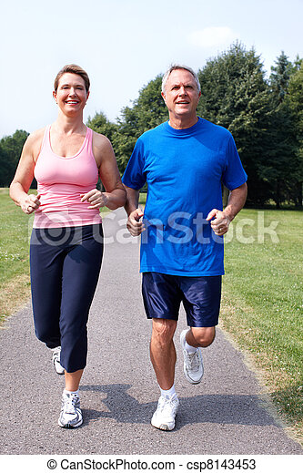 Senior couple jogging in park. - csp8143453