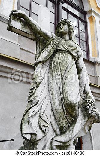 Statue adorns the grave on Nikolskoye cemetery - csp8146430