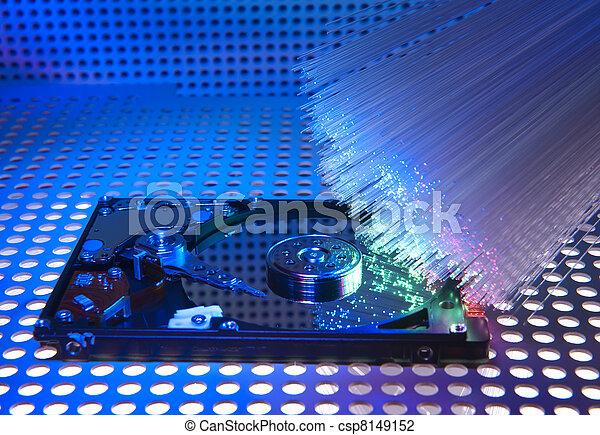 computer harddisk and heads on technology fiber optics background   - csp8149152
