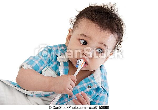 Indian baby brushing teeth - csp8150898