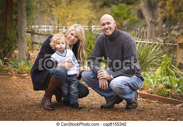 Young Attractive Parents and Child Portrait in Park - csp8155342