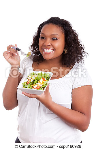 Young african american woman eating salad - csp8160926