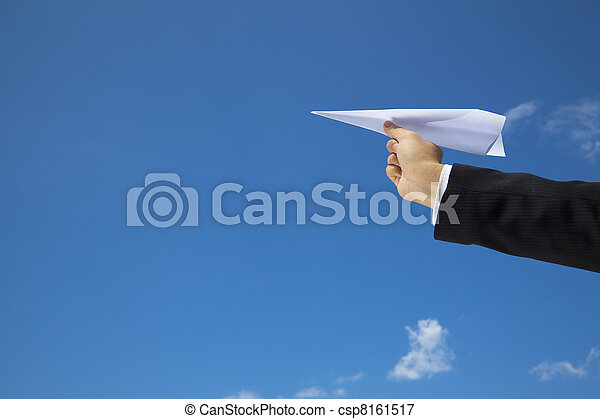 hand of Businessman letting an airplane made of paper fly over blue sky - csp8161517