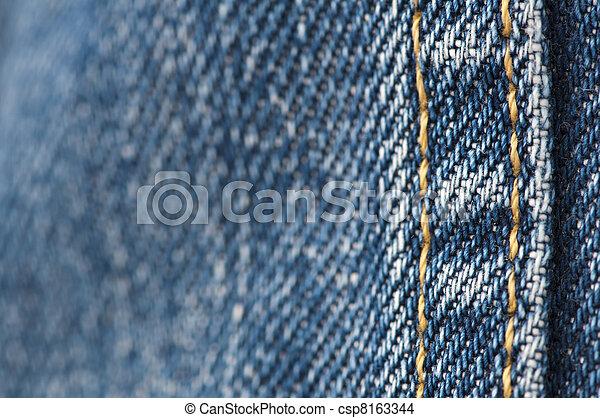 Orange stitch on the denim garment - csp8163344
