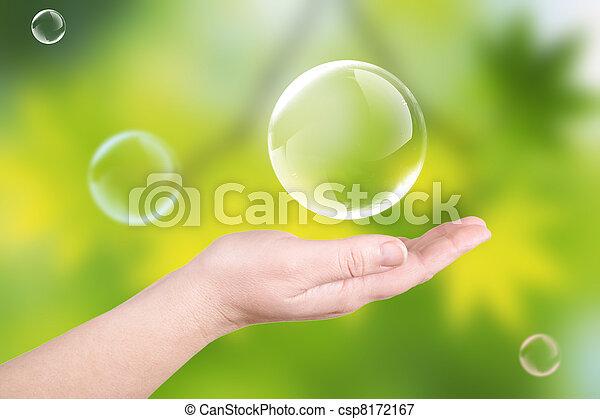 Soap bubbles on a palm - csp8172167