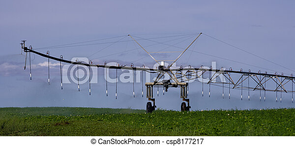 Pivot irrigation system in operation supplying water - csp8177217
