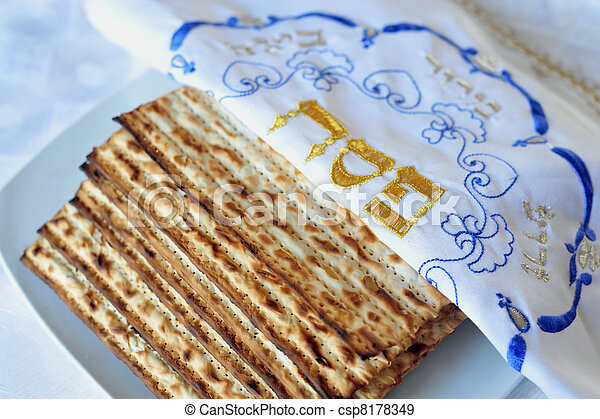 Traditional Jewish Matzo sheet on a Passover Seder table. Passover  is a predominantly Jewish holy day and festival. It commemorates the story of the Exodus, in which the ancient Israelites were freed - csp8178349