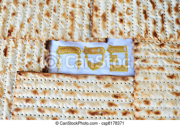 Traditional Jewish Matzo sheet on a Passover Seder table. Passover  is a predominantly Jewish holy day and festival. It commemorates the story of the Exodus, in which the ancient Israelites were freed - csp8178371