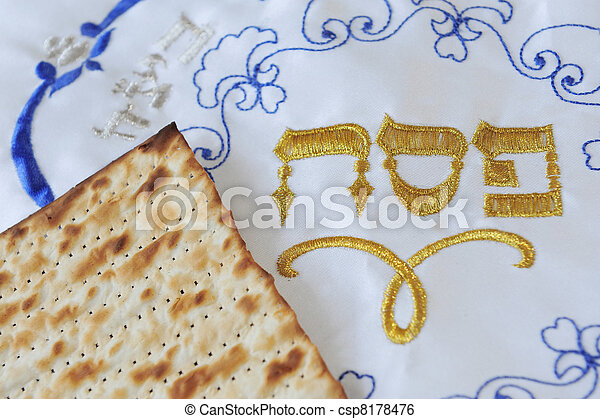 Traditional Jewish Matzo sheet on a Passover Seder table. Passover  is a predominantly Jewish holy day and festival. It commemorates the story of the Exodus, in which the ancient Israelites were freed - csp8178476