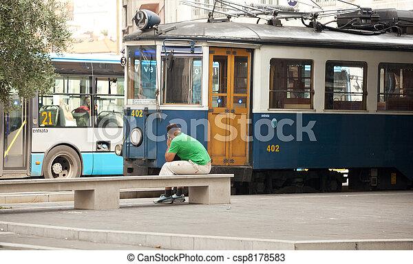 Man looking a tram - csp8178583
