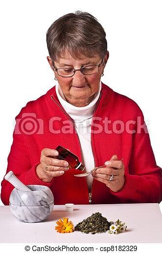 pensioner taking herbal drops - csp8182329