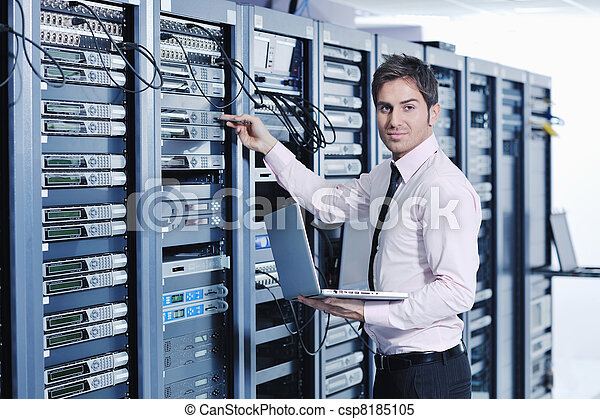 young it engineer in data center server room - csp8185105