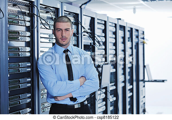young it engineer in data center server room - csp8185122