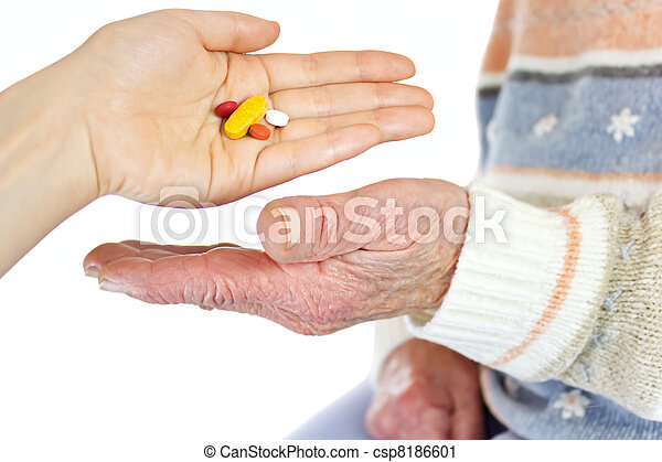 Giving pills to elderly woman - csp8186601