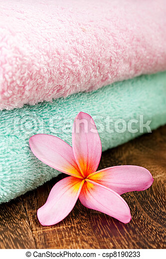 Clean Fresh Towel with Tropical Plumeria for spa and wellness concept focus pointed at the Tropical Plumeria using rule of third (RO3) and shallow DOF - csp8190233